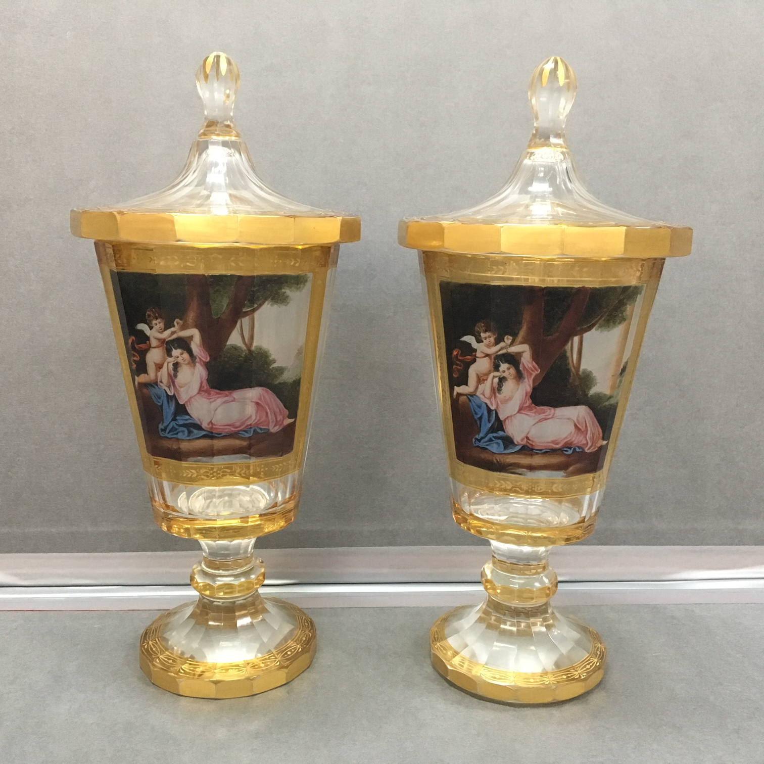 e0db06deecb0 A fine pair of transparent enamelled lidded vases with amber   gilt  decoration